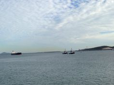 The twins escorting a bulk carrier from Fishermans