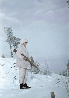 A soldier guarding near Finnish Captain Väänäsen's tent in camouflage jacket holding his Mosin-Nagant in the north-eastern side of the Lake Ladoga, Winter War, 1 February Pin by Paolo Marzioli Russian Winter, Drawing Practice, Vintage Coffee, Soviet Union, Armed Forces, World War, Wwii, Army, Camouflage Jacket
