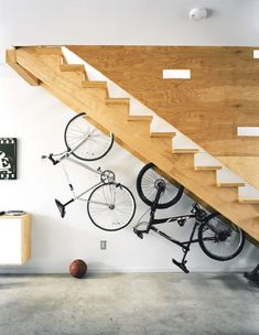 Not sure what to do with the area under your stairs? Here's a clever under stair storage idea - mount your bikes for a clever indoor bike storage solution.