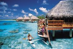 """Bora Bora and my favorite hotel room EVER... complete with your own paddle boat! And near the """"One Chicken Inn"""" restaurant house."""