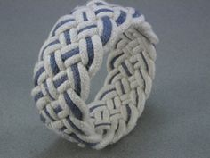 I remember making these, although they never came out this nice.  turks head knot bracelet