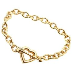 Preowned Tiffany & Co. Heart And Arrow Link Toggle Gold Bracelet ($3,950) ❤ liked on Polyvore featuring men's fashion, men's jewelry, men's bracelets, link bracelets, multiple, mens 18k gold bracelets, mens gold bracelets and mens yellow gold bracelets