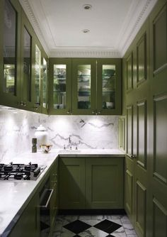 The Best in Dark Green Kitchen Trends - Town & Country Living Olive Green Kitchen Cabinets with Checkerboard Floor Painting Kitchen Cabinets, Kitchen Design Small, Dark Green Kitchen, Kitchen Trends, Green Cabinets, Contemporary Kitchen, Kitchen Cabinet Colors, Kitchen Renovation, Kitchen Paint