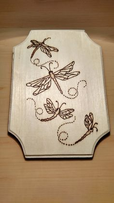Wood burned, dragonflies plaque