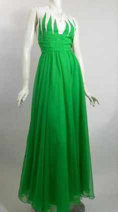 1960s evening gown of kelly green and white silk chiffon. Flame design on bodice front and back dotted with rhinestones, V neck, zips up back. Lined in acetate satin. No flaws. By Nat Kaplan Couture.