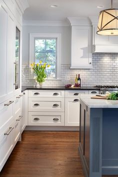Gilday Renovations: Traditional U-shaped kitchen with hidden refrigerator drawers and glass front wine ...