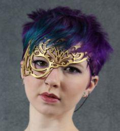 Vixen leather mask in Gold. $32.00, via Etsy.