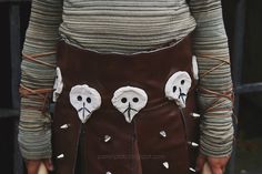 So here's the break down of Ava's Astrid Costume:   t-shirt knit is from here .   faux leather fabric is from here.   silver spikes fro...