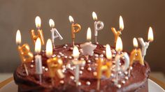 A chocolate birthday cake with candles