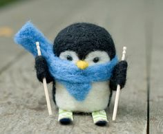 Hey, I found this really awesome Etsy listing at https://www.etsy.com/listing/182057228/needle-felted-penguin-skiing