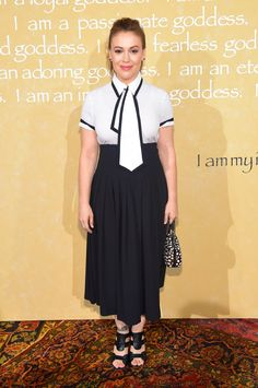 Pin for Later: NYFW's Front Row Is Looking Extremely Fierce Alyssa Milano This ain't your father's tie! We're loving that little something extra on Alyssa Milano's black-and-white top.