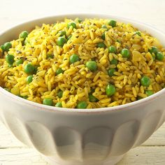 Yellow Rice with Peas Recipe - Turmeric gives this rice side dish its vivid yellow hue.