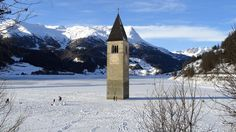 In the Italian Lake Reschen, the steeple of a submerged 14th-century church can be seen protruding from the water. In the winter, when the water freezes, it is possible to walk across to the bell tower.