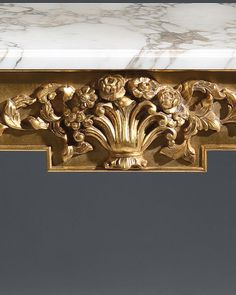 Louis XVI style | console | Louis XVI style carved wood console with floral motif, antique gold leaf finish and Calacatta gold marble top with carved beveled edge