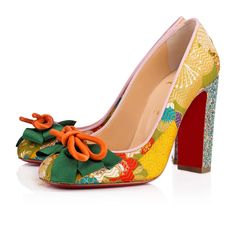 """Christian Louboutin's obsession with the Far East is evident in """"Dolly Dola"""". Her exotic floral print jacquard and kimono wrap inspired bow feature are very Madame Butterfly, while the 100mm dragonfly glitter heel is all Christian."""