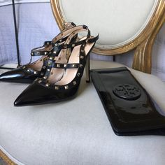 New rock stud style black patent leather heels Black patent leather with gold studs with 5 inch heels. Boutique Shoes Heels