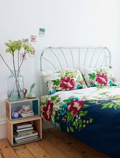 bohemian bedroom with flowers and diy nightstand