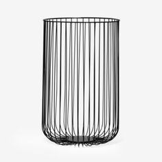 Metal wire waste bin, although it would have to be lined or stuff will fallout. Very much like the look of this.