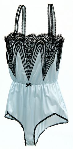 """1984 Powder blue combination with black lace overlays on the front, lace-trimmed straps, lace-trimmed legs, and a tiny black bow on the elastic waist. Made of synthetic fabric. Made by Vassarette, a division of Munsingwear Incorporated, a company based in Minneapolis, Minnesota."" Want."