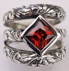 Susan Roos Wild vines - This graceful sterling silver ring consists of three engraved bands soldered together at the bottom and joined at the top by a bright red square 7mm x 7mm cubic zirconia in a silver tube.