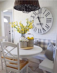 An extra large farmhouse clock is perfect for this cozy kitchen nook!