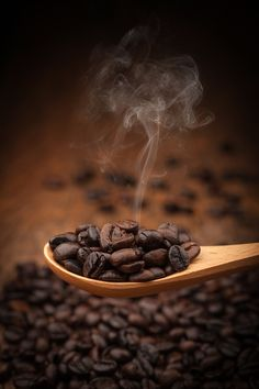 Close up coffee beans on wooden spoon by artintownphotography - 500px
