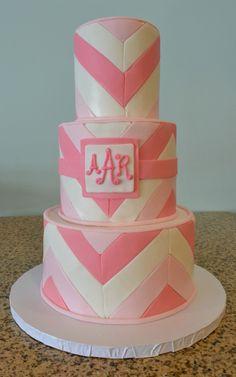 Cute three tier pink chevron cake with monogram