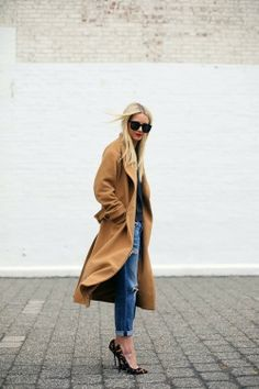 Shop this look for $216:  http://lookastic.com/women/looks/tobacco-overcoat-and-charcoal-crew-neck-t-shirt-and-blue-boyfriend-jeans-and-tan-heels/1092  — Tobacco Overcoat  — Charcoal Crew-neck T-shirt  — Blue Boyfriend Jeans  — Tan Leopard Heels