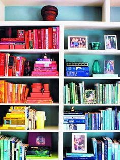 Colour co-ordinated book shelves.