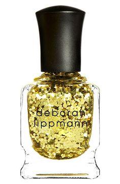 "Deborah Lippmann nail polish in ""Shake Your Groove Thing"" -  a full-on flickering gold glitter"