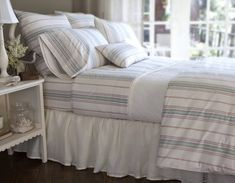 Throw+pillows+in+various+sizes+coordinate+perfectly+with+the+striped+bed+linens.+The+rectangular+accent+pillow+allows+a+bit+of+variation+in+the+horizontal+stripes+of+its+fabric+against+the+vertical+stripes+of+the+linens.