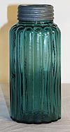 Awesome TEAL Hemingray RIBBED Jar This rare Hemingray ribbed quart jar comes in a deep strong TEAL BLUE. Has a smooth base, thick ground mouth, and a tall threaded neck. Comes with a common zinc band and a plain aqua glass insert closure. Good condition with only some light deposit, and no damage. Does have one manufacturing flaw, a pot