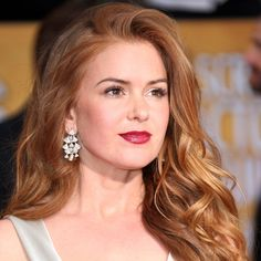 Check out the mix of celebrities who are wearing their hair fiery red. | all about Isla