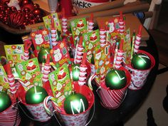 Classroom Gifts: Christmas is all about giving, so make sure you don't forget to include your kiddo's classmates. In this gift basket, include small little gift items such as an ornament with each student's name or initial on it, stickers, pencils, candy canes, and other Christmas related items.