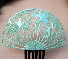 Large Art Deco Hair Comb Jade Green Fighting Parrots. This comb is of the type known as a Spanish or mantilla comb because it resembles the traditional ornaments worn by Spanish ladies with their native dress. This large and handsome example is made in opaque jade coloured celluloid.