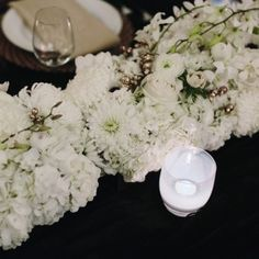 This elegant assortment of white flowers always looks classy, timeless, and is an easy DIY | Real Wedding: Gary Ireland and Gilbert Archuleta | Photo by: James Moes | Seattle Met Bride and Groom W/S 13