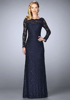 Timeless lace evening gown with sheer scalloped neckline and sleeves. Back zipper closure. Evening Size Chart B.