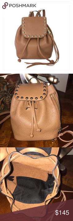"""Rebecca Minkoff Micro Unlined backpack 🎒 Rebecca Minkoff Micro Unlined Backpack   Soft buttery leather, bad-girl studs, and bohemian fringe all come together on this bucket-style backpack. Stuff it with your itty-bitty essentials, sling it over your shoulder, and hit the town. 7.5""""W x 9""""H x 6""""D Genuine leather adult backpack strap Custom light gold hardware side zipper pocket Almond color ! 💕in pristine condition! 👌🏻🚫no trades 🚫 Rebecca Minkoff Bags Backpacks"""