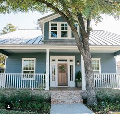 Beautiful blue house front with great curb appeal from Fixer Upper. Craftsman style house front door combined with the blue and white trim make the perfect exterior paint scheme. House, Fixer Upper House, House Exterior, Pig House, Three Little Pigs Houses, Farm House Colors, Exterior Design, House Painting, House Exterior Blue