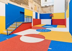 Ill-Studio has collaborated with French fashion brand Pigalle to create a multicoloured basketball court between a row of buildings in the 9th arrondissement of Paris.
