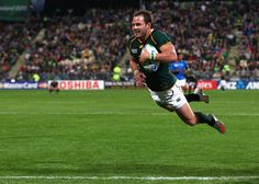 Francois Hougaard of South Africa goes over to score his second and the Springnoks twelfth try during the IRB 2011 Rugby World Cup Pool B match between South Africa and Namibia at North Harbour Stadium on September 2011 in Auckland, New Zealand. South African Rugby, International Rugby, Sports 5, Rugby Men, Rugby World Cup, Rugby Players, Real Man, Surfing, Soccer