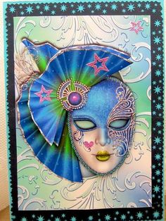 Blue Masque on Shimmering Frame decoupage on Craftsuprint designed by Anne Lever - made by Darlene Handorff - Oh what fun I had with this pattern. I printed onto glossy photo paper and cut out the pattern pieces. I used a decorative cutter for the starry celestial look and attached that to a turquoise card stock. I added the largest piece with DST and then attached the face after cutting out the white portion of the eyes and headwear again with dimensional foam. I added green lips and the…