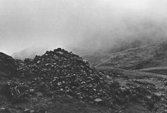 Richard Long: A Thousand Stones Added To The Footpath Cairn, England, 1974.
