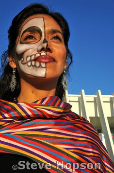 Dia de los Muertos    Artist Yuyi Morales with a painted face at the Día de los Muertos celebration at the Mexican American Cultural Center in Austin Texas, November 1, 2008. Día de los Muertos (Day of the Dead) is a holiday celebrated mainly in Mexico and by people of Mexican heritage focusing on gatherings of family and friends to remember friends and relatives who have died. Traditions include building private altars honoring the deceased, using sugar skulls, marigolds, and the favorite…
