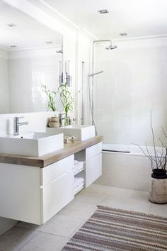 White bathroom; #bathroom tiles, shower, vanity, mirror, faucets, sanitaryware, #interiordesign, mosaics, modern, jacuzzi, bathtub, tempered glass, washbasins, shower panels #decorating