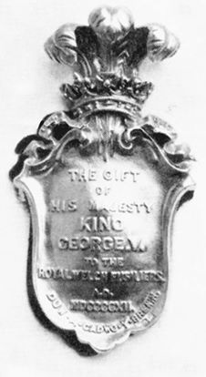 An example of the silver head plate, which successive Monarchs have presented to the 1st Battalion, The Royal Welch Fusiliers to be worn by the goat within their reign,