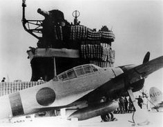 """An Imperial Japanese Navy Mitsubishi A6M2 """"Zero"""" fighter on the aircraft carrier Akagi during the Pearl Harbor attack mission. http://on.fb.me/1PJWYGx"""