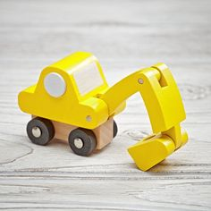 Shop Toy Excavator.  These classic vehicles feature simple and colorful designs making them perfect for imaginary play.  And they're compact enough to be the perfect stocking stuffer.