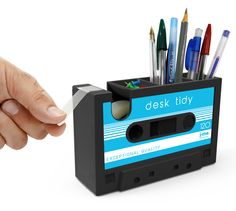 rewind back the years! another play on the retro cool cassette tape offering storage for your pens, pencils & small stationery items as well as the ability to dispense sticky tape.
