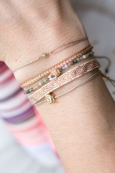 Get carried away by the sense of summer, sea & sunshine! Shiny gemstones & gold plated highlights make this arm candy to something special #bracelets #gemstones #shell WWW.NEWONE-SHOP.COM